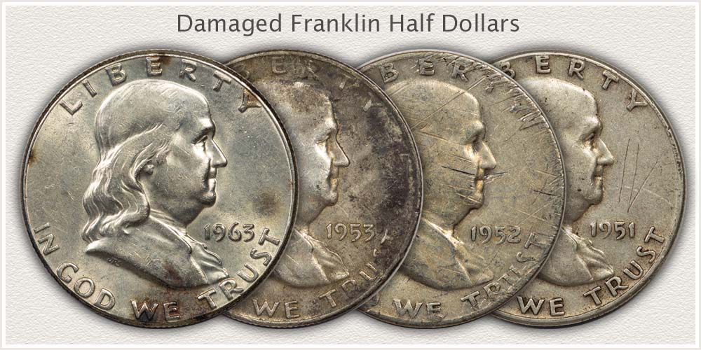 Four Franklin Half Dollars with Damage to Surfaces